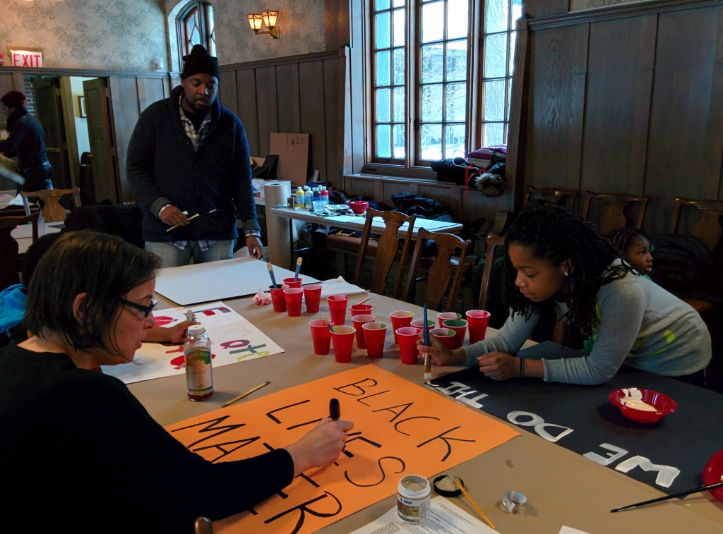 Youth organizer Jakya Hobbs works alongside adult allies to create signage for Chicago's installment of Reclaim MLK.  Photo: Kelly Hayes