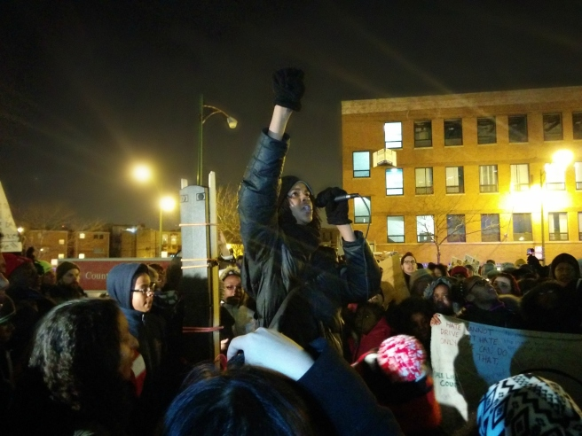 Kaleb Autman leads the crowd in a chant of solidarity with the incarcerated youth. (Photo: Kelly Hayes)
