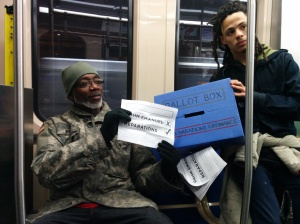 Another commuter rejects Rahm Emanuel in support of the reparations ordinance. (Photo: Kelly Hayes)