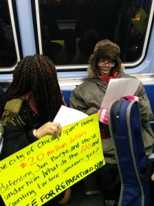 Chicago Light Brigade member Cairá Lee Conner discusses the reparations ordinance with commuters on the Red Line. (Photo: Kelly Hayes)
