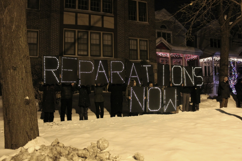 After holding up their message directly in front of Rahm Emanuel's home, activists crossed the street to make sure the mayor could clearly read the light banner from his window. Lights went on at the front of the house during the protest. Rahm Emanuel was reportedly home at the time. (Photo: Kelly Hayes)