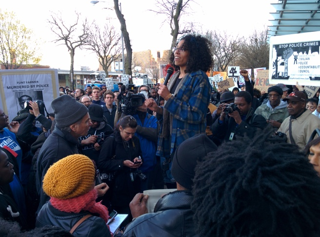 Organizer Page May reminds the crowd to honor Black women killed by police, as well as Black men. (Photo: Kelly Hayes)