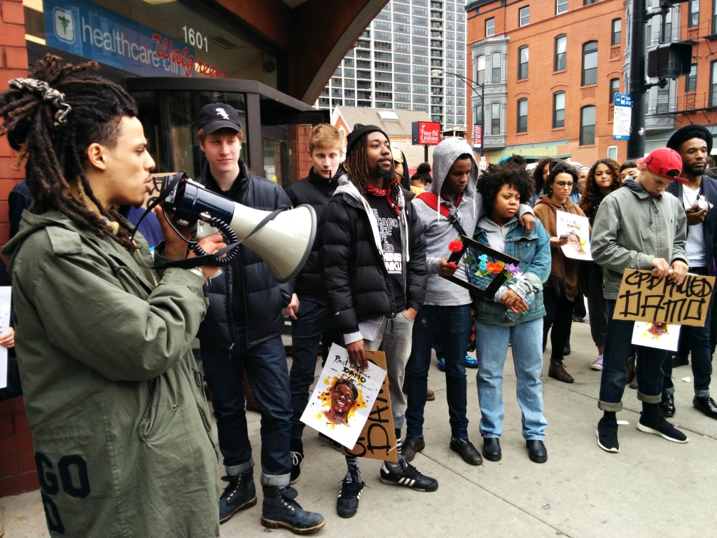 Damo's friends and supporters of We Charge Genocide gather outside the Walgreens where Damo ran from police, just before being tased to death for stealing a bottle of liquor. (Photo: Kelly Hayes)
