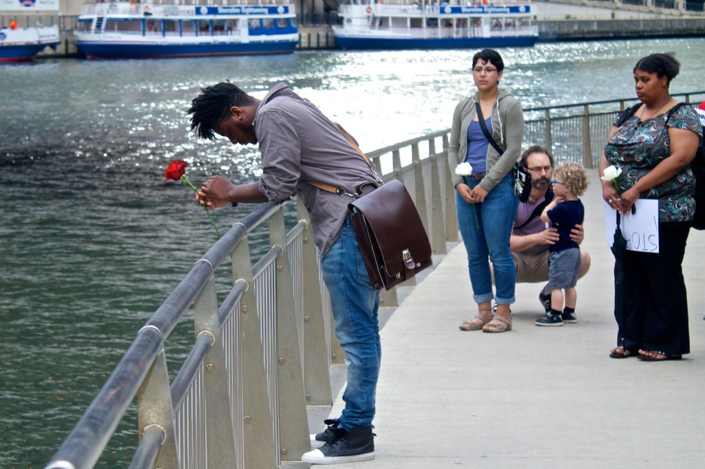 Chicago poet and organizer Malcolm London mourns beside the Chicago River at a vigil for the victims of Wednesday's massacre. (Photo: Bob Simpson)