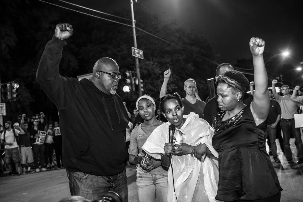 Dyett hunger strikers take center stage when an action for Rekia Boyd converged with a vigil for Dyett High School Thursday night in Chicago. (Photo: Sarah Jane Rhee)